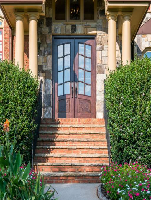 Classic French Front Door featuring a Light Double Rectangular Composite Wood Door with Winterlake Glass and Emtek Locksets