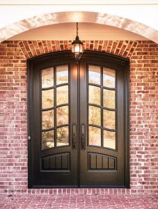Classic French Front Door featuring a Dark Double Rounded Composite Wood Door with Winterlake Glass and Emtek Locksets