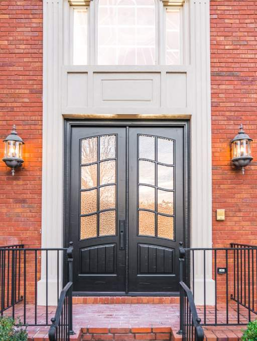 Classic French Front Door featuring a Dark Double Rectangular Composite Wood Door with Monumental Glass and Emtek Locksets