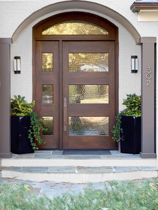Modern Contemporary Front Door featuring a Cherry Single Arched Composite Iron Wood Door with Transom Monumental Glass Side Lights and Emtek Locksets