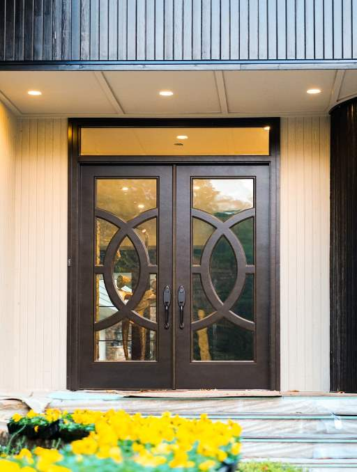 Modern Door featuring a Dark Double Rectangular Composite Iron Wood Door with Transom German Antique Glass Concentric Circles and Emtek Locksets