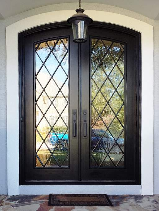 Modern French Front Door featuring a Dark Double Arched Composite Wood Door with Privacy Glass and farmhouse diamond
