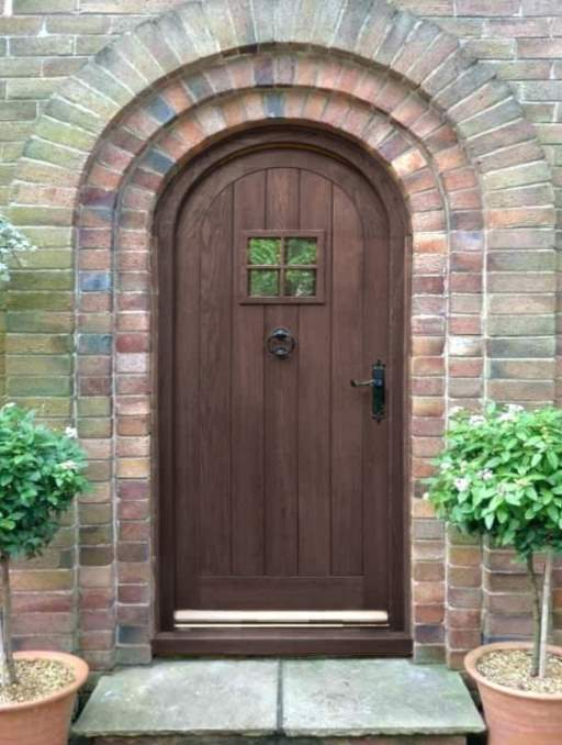 Rustic Front Door featuring a Dark Single Rounded Composite Iron Wood Door with Privacy Glass Emtek Locksets