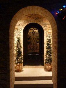 Almaria Front Door featuring a Dark Single Rounded Composite Iron Wood Door with Glacier Glass Emtek Locksets