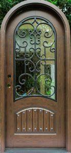 Almaria Front Door featuring a Bronze Single Rounded Composite Iron Wood Door with Glacier Glass Emtek Locksets