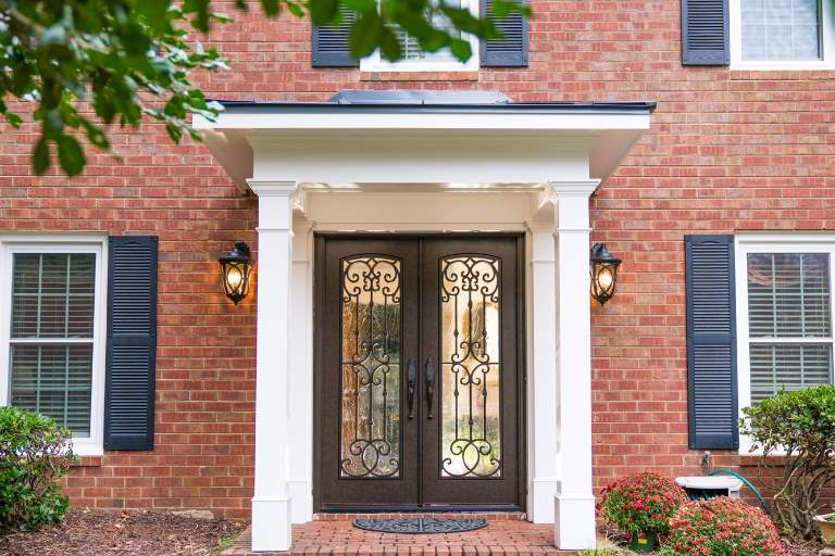 Almaria Front Door featuring a Dark Double Rectangular Composite Iron Wood Door with Winterlake Glass Emtek Locksets