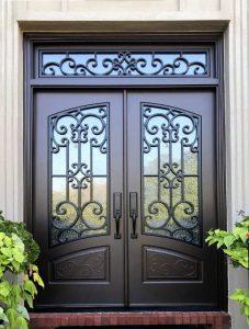 Almaria Front Door featuring a Dark Double Rectangular Composite Iron Wood Door with Transom Monumental Glass Emtek Locksets