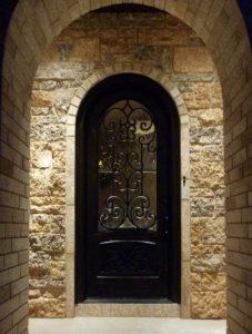 Almaria Front Door featuring a Dark Single Rounded Composite Iron Wood Door with Glacier Glass and Emtek Locksets