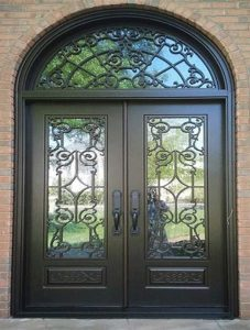 Chateau Front Door featuring a Dark Double Arched Composite Iron Wood Door with Transom Winterlake Glass and Emtek Locksets