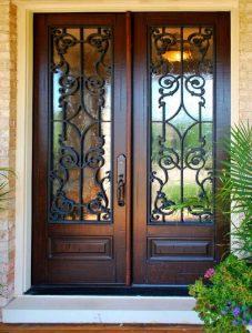 Chateau Front Door featuring a Bronze Double Rectangular Composite Iron Wood Door with Winterlake Glass and Emtek Locksets