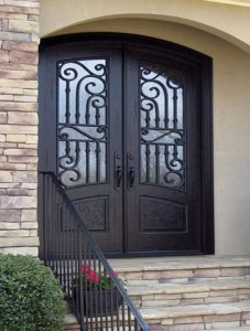 Corinthian Front Door featuring a Dark Double Arched Composite Iron Wood Door with Privacy Glass and Emtek Locksets
