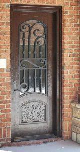 Corinthian Front Door featuring a Bronze Single Rectangular Composite Iron Wood Door with Privacy Glass and Emtek Locksets