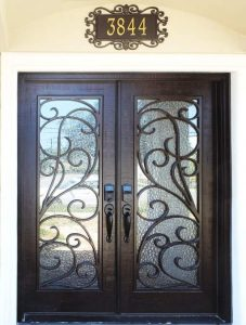 Montelucci Front Door featuring a Dark Double Rectangular Composite Iron Wood Door with Monumental Glass and Swirl Pattern