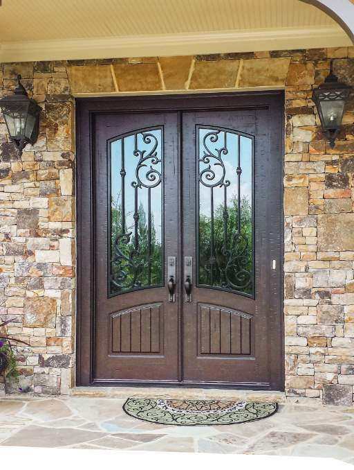 Orleans Front Door featuring a Dark Double Rectangular Composite Iron Wood Door with Winterlake Glass and Emtek Locksets