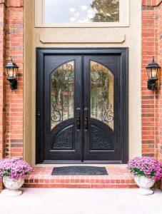 Orleans Front Door featuring a Dark Double Rectangular Composite Iron Wood Door with Winterlake Glass and Emtek Locksets