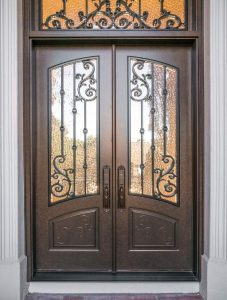 Orleans Front Door featuring a Bronze Double Rectangular Composite Iron Wood Door with Transom Monumental Glass and Emtek Locksets