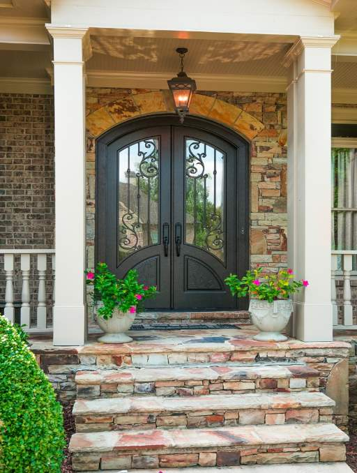 Orleans Front Door featuring a Bronze Double Arched Composite Iron Wood Door with Transom Privacy Glass and Emtek Locksets