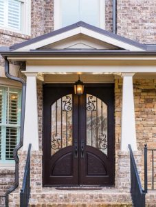 Orleans Front Door featuring a Dark Double Rectangular Composite Iron Wood Door with Transom Winterlake Glass and Emtek Locksets