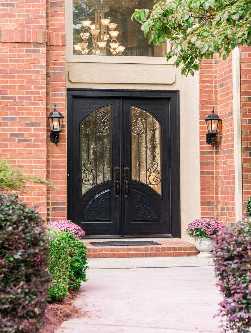 Orleans Front Door featuring a Dark Double Rectangular Composite Iron Wood Door with Transom Winterlake Glass and Emtek Locksets
