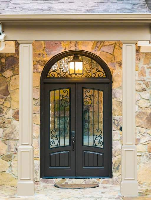 Orleans Front Door featuring a Dark Double Rectangular Composite Iron Wood Door with Transom Glacier Glass and Emtek Locksets