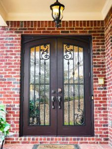 Orleans Front Door featuring a Dark Double Arched Composite Iron Wood Door with Glacier Glass and Emtek Locksets