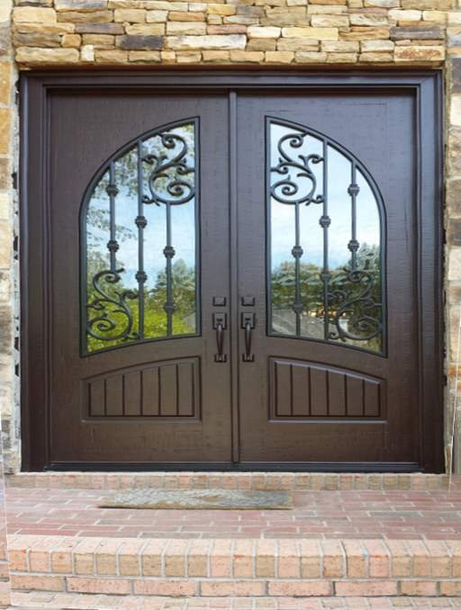 Orleans Front Door featuring a Dark Double Rectangular Composite Iron Wood Door with Glacier Glass and Emtek Locksets
