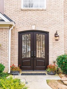 Orleans Front Door featuring a Dark Double Arched Composite Iron Wood Door with Monumental Glass and Emtek Locksets