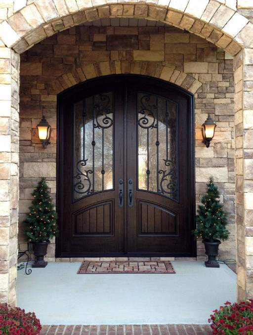 Orleans Front Door featuring a Dark Double Arched Composite Iron Wood Door with Winterlake Glass and Emtek Locksets