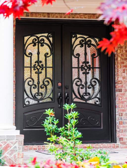 Paris Front Door featuring a Dark Double Rectangular Composite Iron Wood Door with Monumental Glass and Emtek Locksets