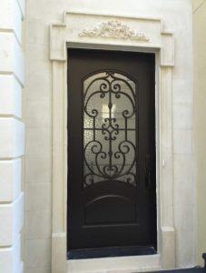 Paris Front Door featuring a Dark Single Rectangular Composite Iron Wood Door with Monumental Glass and Emtek Locksets