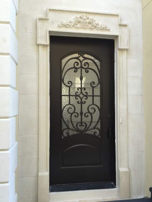 Paris Front Door featuring a Dark Single Rectangular Composite Iron Wood Door with Monumental Glass and Emtek Locksets