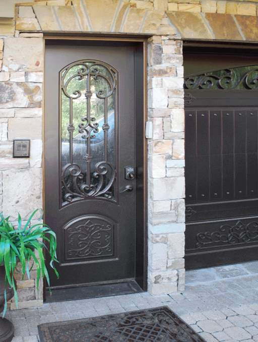 Paris Front Door featuring a Dark Single Rectangular Composite Iron Wood Door with Winterlake Glass and Emtek Locksets