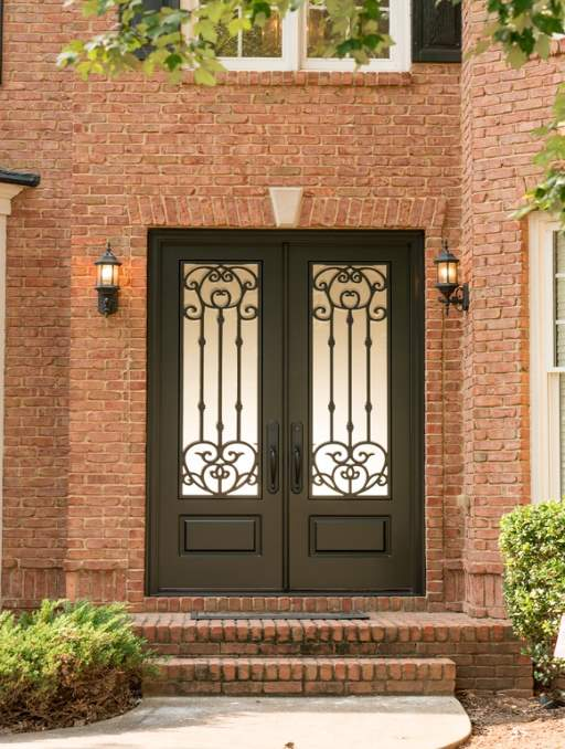 Versailles Front Door featuring a Dark Double Arched Composite Iron Wood Door with Privacy Glass and Emtek Locksets