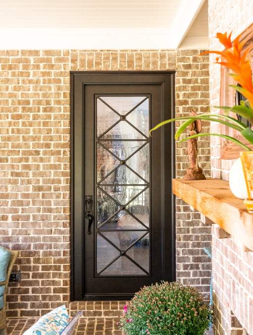 Modern Farmhouse Front Door featuring a Bronze Single Rectangular Composite Wood Door with Winterlake Glass Criss Cross Pattern and Emtek Locksets