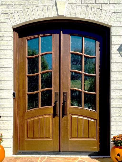 Classic French Front Entry Door featuring a Vintage Cedar Double Arched Composite Wood Door with Winterlake glass and Farmhouse Emtek Locksets