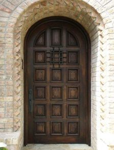 Rustic Door featuring a Dark Single Rounded Composite Iron Wood Door with No Glass Square Pattern and Emtek Locksets